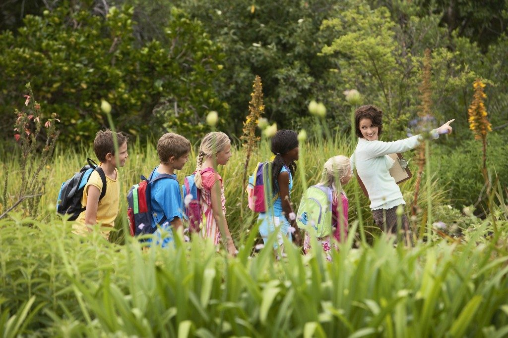 Teacher with children with nature friendship